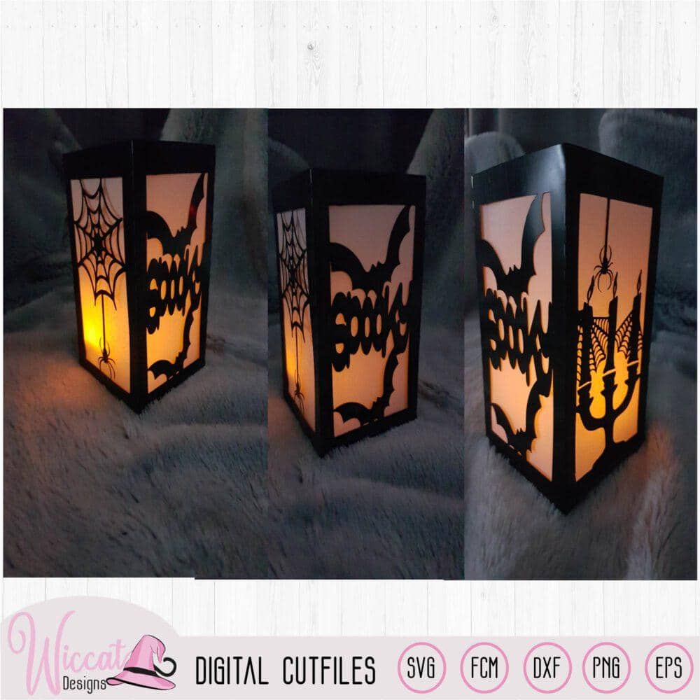 Spooky lantern, candles with bats and spiders,